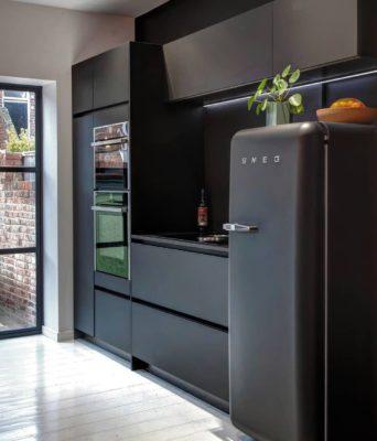 Black on black kitchen inspiration with Fenix and Smeg