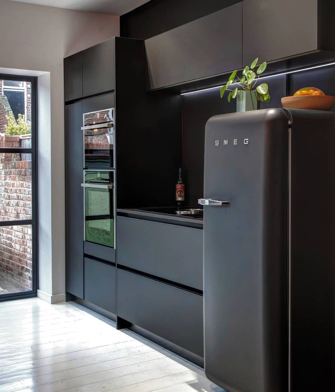 Black on black kitchen inspiration with Fenix and Smeg FAB28